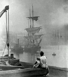 A woman and child look toward a ship on the Thames, 1880.  Photo credit: Sunderland Antiquarian Society — in London, United Kingdom