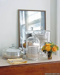 Put fine china on display in the dining room without buying a breakfront or hutch. Keep dishware on a side table on covered cake stands and under bell jars and cloches.