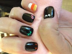 Halloween nail design, monster eyes and candy corn.