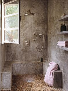 Oh my!! Perhaps my most realistic dream shower?? love that pebbly floor, the seating, the window, the walls w/ shelf, the rain shower head...