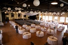 the ceremony and reception in one spot. white round tables, paper lanterns, and string lights - thereddirtbride.com - see more of this wedding here