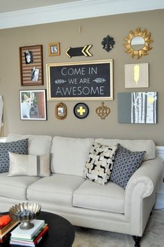 #DIY Black Gold #GalleryWall, Gallery Wall, eclectic art wall, art grouping, repurpose thrift store pics, birch tree, chalkboard, free printables, gold feather, swiss cross, gold sun mirror, black painted arrow, black & gold gallery wall, See the transformation on madeinaday.com