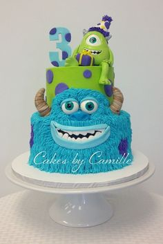 Monsters Inc, University Cake, Sulley is piped buttercream with fondant accents, Mike is sculpted from fondant, Top tier smooth buttercream.