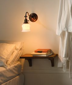 Two simple brackets and a piece of wood = bedside ledge for the basics. Nice!