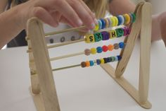 Need to a project to keep your little ones busy this summer? Have them make an abacus!