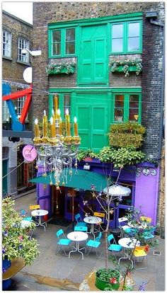 Neals Yard, a small alley in Covent Garden between Shorts Gardens and Monmouth Street which opens into a courtyard.