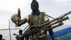 Militants wearing black masks patrol the creeks of the Niger Delta area of Nigeria. (File photo)