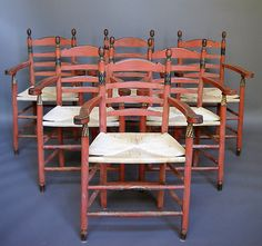 """Set of six armchairs from the Scandinavian Arts  Crafts movement, circa 1900, strongly influenced by Ernest Gimson's designs. Straight legs, ladder back, and rush seats. Original decorative paint.  H:37½"""" (seat, 19""""), W:23½"""", D:20"""" (seat depth, 15½"""").  Ref. #31-02"""