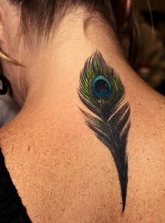 Graceful peacock feather watercolor tattoo on neck for girls