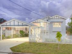 Queenslander house at 42 Devonshire Street, Ashgrove - love the fence.
