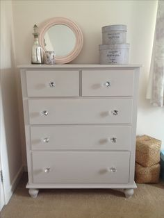Painted in Farrow and Ball Elephant's Breath and glass handles added - perfect addition to our bedroom