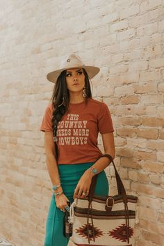 This Country Needs More Cowboys Graphic Tee - Clay The This Country Needs More Cowboys Graphic Tee features a unisex body in heathered clay with ivory screen printed artwork. Sizes: S-XL Rodeo Outfits, Casual Dress Outfits, Cute Outfits, Fashion Outfits, Summer Cowgirl Outfits, Cowgirl Style Outfits, Cowgirl Dresses, Western Dresses, Winter Outfits