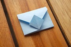 From a square piece of paper, fold it into an origami envelope. :: quick, easy, and a way to send a private note or letter in an artsy way! <3