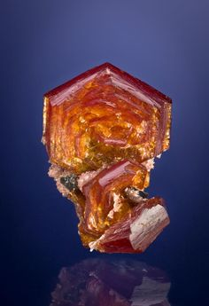 Shigaite crystal. A very uncom-mon mineral, this extremely hydrated (has 8 to 22 waters in its chemical formula) Mangan-ese-Aluminum sulfate is captured here in a Joe Budd image. Shigaite was discovered in Shiga Perfecture, Japan, 27 years ago. Shigaite is also found in Michigan's Iron Range, Mont Saint-Hilaire-Quebec, and at the Wessels Mine in South Africa.