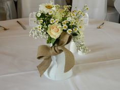 Simple metal jugs filled with flowers makes a great statement.   www.blueorchid-events.com