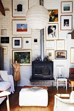 Love the fireplace, exposed brick and gallery wall combination.