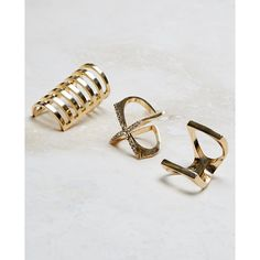 Finesse Novelty Corp  Geo Rhinestone X Ring Trio ($9.90) ❤ liked on Polyvore featuring gold and wet seal