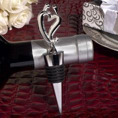 "Two Hearts Become One Silver Wine Stopper - The Two Hearts Become One Silver Wine Stopper makes lovely favors for weddings and anniversaries. These stylish wine stops feature a silver chrome heart bottle stopper and sturdy chrome base, all measuring 4.5"" in length. http://www.favorfavor.com/page/FF/PROD/DC1455"
