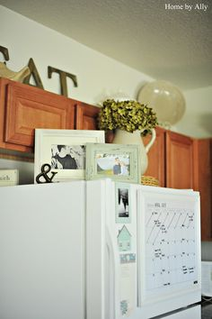 Cute Picture Frames On Top Of Fridge! Doing This! Fridge DecorCute Picture  FramesCabinet ...