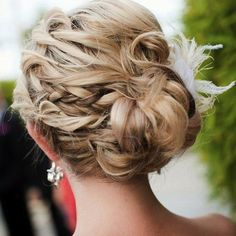 http://beauty.about.com/od/homecominghairstyles/ss/Sideswept-Buns_15.htm