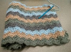 The beginnings of a small afghan and also my first big crochet project. I'm using a relatively simple wave pattern that can be found at http://vannaschoice.lionbrand.com/patterns/90346AD.html