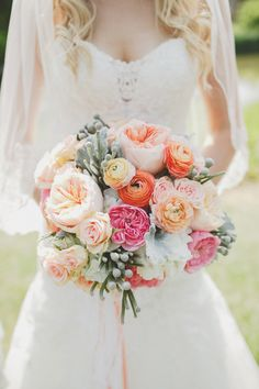 Beautiful coral, peach and green bouquet | Photography: Sugar And Soul Photography - sugarandsoulphotography.com  Read More: http://www.stylemepretty.com/canada-weddings/2014/11/04/romantic-rustic-wedding-in-winnipeg/