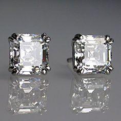 Diamonds both D colour, V,V,SI and V,V S2. Total weight of diamonds 3.10ct.