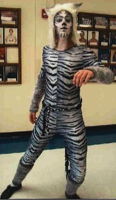 "The costume of one cat's character was built from a printed like ""zebra"" jersey stretch fabric. With a white fur headpiece, knitted gloves and legs' pieces the costume looks perfect for a stage!"