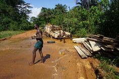 Helping the boys unload their truck to get them out of a mud hole in Guinea (photo from passenger Baz on our Dakar to Freetown trip in October West Africa, Roads, Mud, Truck, October, Characters, Travel, Road Routes, Trucks