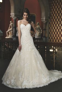 Beaded and corded lace appliques overlay a sequined lining in this sweetheart neckline A-line by Justin Alexander #8701 price $1750 #bridal gown #weddings http://www.victoriarosebridals.com/shop/justin-alexander-8701/