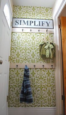 Another fantastic replacement for wallpaper is wrapping paper! Wendy from Shabby Nest used wrapping paper to give her mudroom a custom look....
