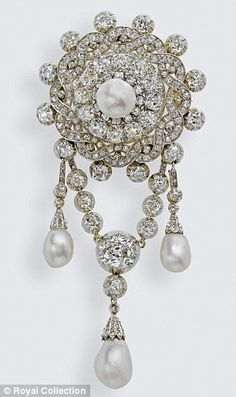 The Emperor of Austria Brooch, aka the Teck Corsage Brooch.  Composed of a central large pearl surrounded by braided rows of diamonds with twelve collets around the exterior & a removable pendant chain of collets with three pendant pearls, this brooch was owned by Queen Mary's mother, the Duchess of Teck.  The Emperor Franz Joseph of Austria gave it to her when he was named godfather of her son, Prince Francis.