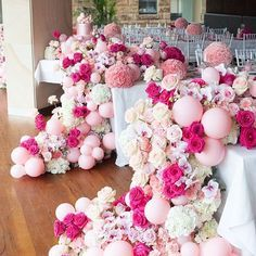 EVENT . A pink and playful floral palette of cascading Cymbidium Orchids, Carnations, Hydrangeas, Phalaenopsis Orchids, and Columbian Roses cascaded 2 metres off the table settings with pops of pink balloons to add drama and fun. 'Bubble' like shaped floral moments created from carnations and roses in tones of pretty pinks were strategically positioned at various heights throughout the tables. #jasonjamesdesign Florals @seedflora Balloons @pinkmixparties