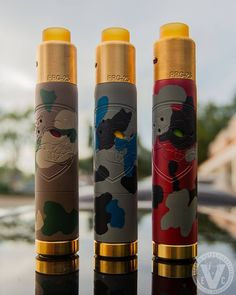 "The Skull ""Camo Edition"" Mech Mod & PRG-25 RDA Bundle by Purge Mods utilizes Purge's signature firing switch, double-wall body for heat resistance, and hybrid-connection for optimal power output! _________________________ Available Serial Numbers: ️Desert Camo: 52 ️Blue Camo: 79 ️Red Camo: 74"