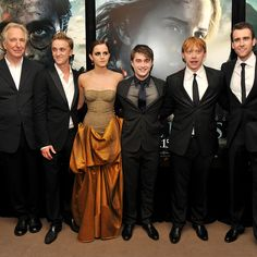 Emma Watson really stands out because she's the only one not wearing black. Even the guys' ties are black!