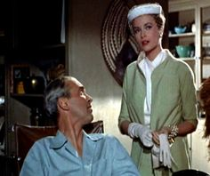 Grace Kelly in Rear Window. Love the green suit, especially with the hat and gloves.