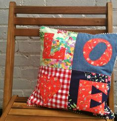 Patchwork applique LOVE cushion pillow: wonderful mix of fabrics and nice detail with the rick rack