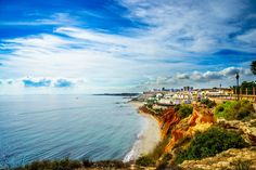 Red cliffs at Cabo Roig by Joachim Andersson on 500px