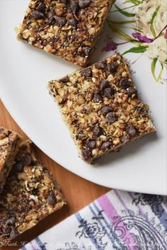 These healthier homemade granola squares are made using quick cooking oats, chia seeds, honey, peanut butter, and a small dose of miniature chocolate chips.
