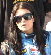 Danica Patrick. In 2008 she became the first woman to win and Indy car race. Began racing NASCAR in 2010. Finish 4th in series in 2011 - the best finish by a woman in a NASCAR top-circuit.   SHE MY GIRL !!