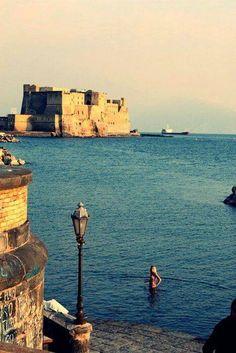 Napoli, having a bath in the sea at dawn with Castle dell'Ovo behind.  www.facebook.com/napoliadhoc
