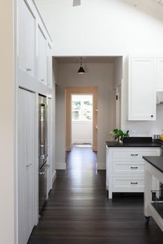 Dark wood floors white trim and doors wall color Its all