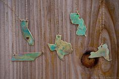 Wear your home state close to your heart with these gorgeous patinated brass pendants.