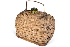 French wine bottle in wicker basket - how interesting