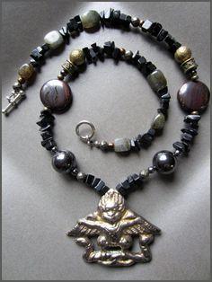 Black Onyx Strand with Tibetan Amulet by DeborahGarnerDesign