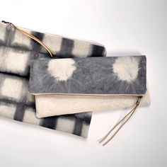 A personal favorite from my Etsy shop https://www.etsy.com/listing/258090215/shibori-linen-clutch-bag-12x10-hand-dyed