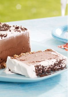 Chocolate Cookie Ice Cream Slice – Layers of chocolate ice cream, COOL WHIP, and shaved chocolate on a chocolate chip cookie crust make for a dreamy no-bake dessert recipe.