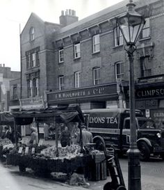 Portobello Market circa  1958. When Woolworths ruled the High Street . Great photograph.
