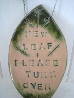 New Leaf  Please Turn Over Strung with wire -- A good reminder.  Every day is a new day and a time to make a fresh start.