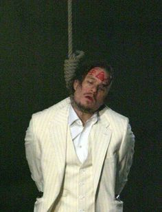 Predictive programming displaying the ritualistic sacrificial murder of Heath Ledger who is depicted as dead while hanging from a noose with Masonic symbols scribed on his forehead in The Imaginarium Of Doctor Parnassus. Released in 2009, the film had not even been completed by the time of his death and had to be finished by a cast of his close friends including Johnny Depp. While intriguing, this movie is chock-full of occult, esoteric and Masonic subliminal symbolism as well as imagery.